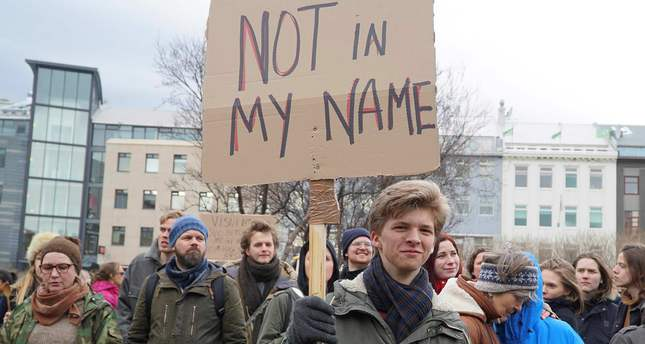 People protest against the prime minister in front of the parliament building in Reykjavik, Iceland.