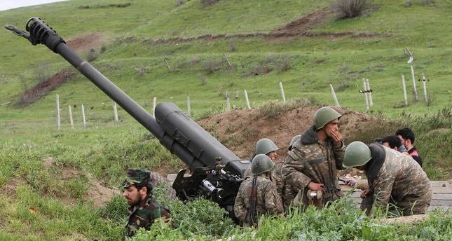 Armenian militias use heavy weapons to attack Azerbaijani military units in Nagorno-Karabakh region.