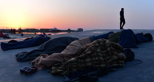 People sleeping in the port of Chios, where refugees and migrants who managed to leave the VIAL detention center a few days ago are camping out.
