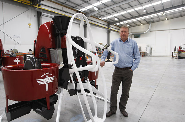 Martin Aircraft CEO Peter Coker stands next to a Martin Jetpack in Christchurch, New Zealand. The company says it's close to commercial liftoff, but the man who started it fears his vision of a personal jetpack will remain grounded. (AP Photo)
