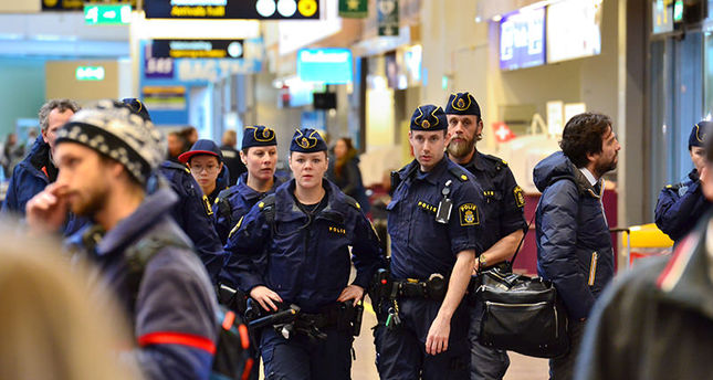 Swedish police patrol in Arlanda airport outside Stockholm, Sweden, Tuesday, March 22, 2016 (AP Photo)