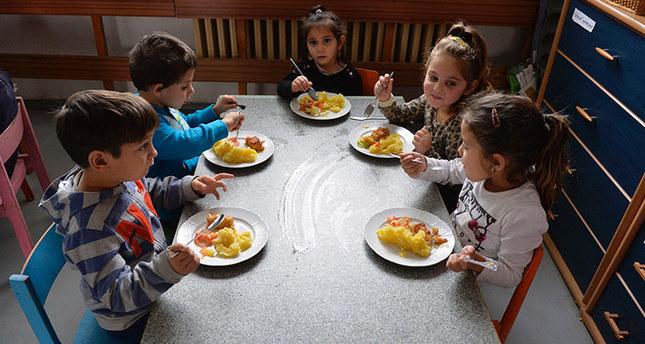 This file photo taken on December 11, 2015 shows children eating lunch in their kindergarten at Hrebendova street in the Lunik IX borough of Kosice. AFP Photo