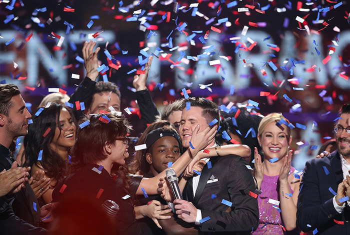 Trent Harmon, center, winner of ,American Idol, The Farewell Season celebrates with fellow contestants during the season finale at the Dolby Theatre on Thursday, April 7, 2016, in Los Angeles. (AP Photo)