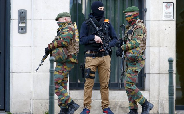 Belgian soldiers and special forces police keep guard outside a courthouse as Paris attacks suspect Salah Abdelslam remains in police custody in Brussels, Belgium on April 7.