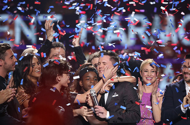Trent Harmon, center, winner of American Idol The Farewell Season celebrates with fellow contestants during the season finale at the Dolby Theatre on Thursday, April 7, 2016, in Los Angeles. (AP Photo)