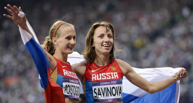 Russian Mariya Savinova (R) and Ekaterina Poistogova celebrating after placing first and third respectively in the women's 800m final at the London 2012 Olympic Games (EPA Photo)