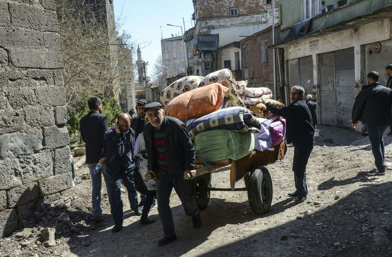 People carry their belongings on a cart as they return to their homes after clashes ended in the Sur district of Diyarbaku0131r in southeast Turkey.