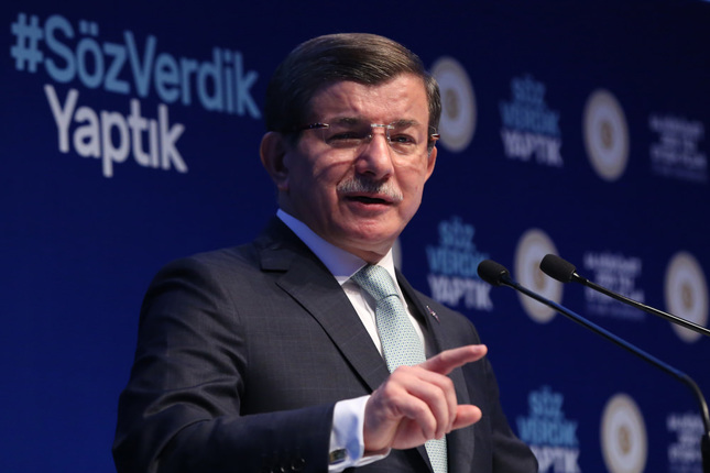 Prime Minister Davutoğlu speaks at the 2016 Action Plan meeting in Istanbul. In the background, is  the hashtag #SözVerdikYaptık  (We promised, we did.)
