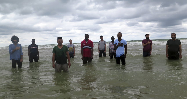 """A scene from the video exhibition """"Just Before Paradise."""" The exhibition draws attention to forced migration and the refugee crisis and also depicts the tides between death and life as a boundless crisis instead of a regional one."""