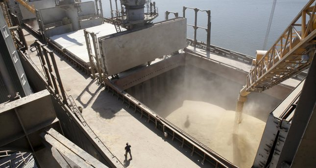 A dockyard worker watches as barley is mechanically poured into a 40,000 ton ship at a Ukrainian agricultural exporter's shipment terminal in the Black Sea port of Nikolayev, now known as Mykolaiv, Ukraine.
