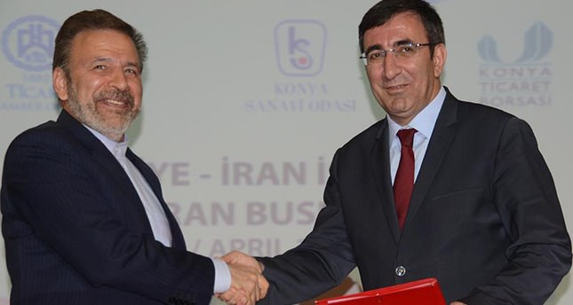 Turkey's Development Minister Cevdet Yılmaz (R) with Iranian Communication Minister Mahmoud Vaezi (L)  (DHA Photo)
