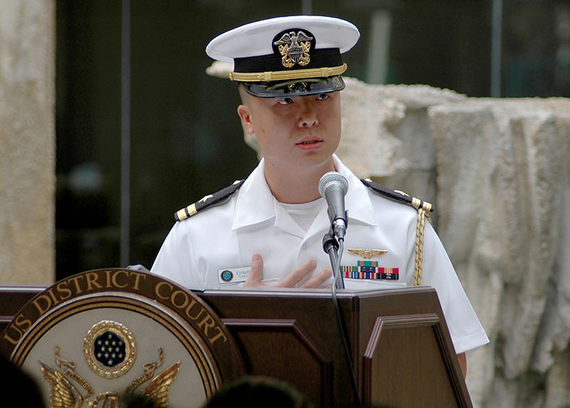 In this December 3, 2008 US Navy handout photo, shows Lt. Edward Lin, a native of Taiwan, shares his personal stories about his journey to American citizenship. (AFP Photo)