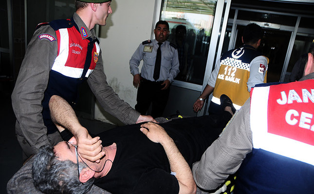 This photo dated April 11, 2016 shows Necmettin Altındöken being transferred to hospital. (IHA Photo)