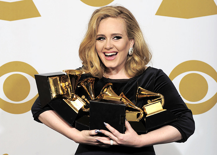Adele poses backstage with her six awards at the 54th annual Grammy Awards on Sunday, Feb. 12, 2012 in Los Angeles, USA (AP Photo)