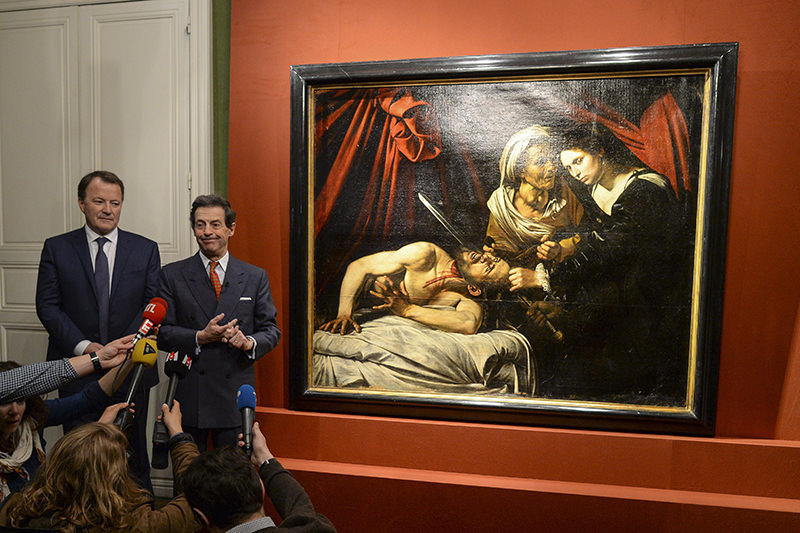 Art expert Eric Turquin(R) and Auctioneer Marc Labarbe (L) pose for photographs as they present the piece u2018Judith Beheading Holofernesu2019. (EPA Photo)