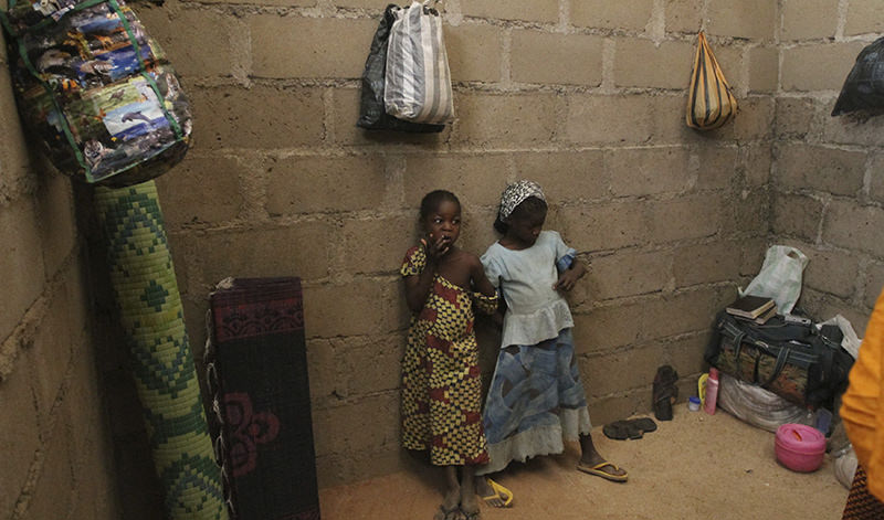 Children, who escaped Boko Haram attacks in both Michika and Cameroon, are seen inside an uncompleted house as they seek shelter in Adamawa Jan. 31, 2015 (Reuters Photo)