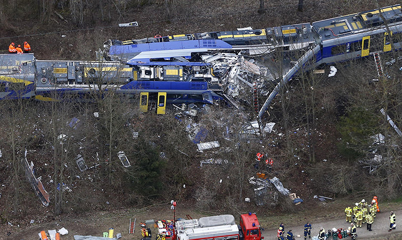 This Tuesday, Feb. 9, 2016 file photo shows an aerial view of rescue teams at the site where two trains collided head-on near Bad Aibling, Germany (AP Photo)