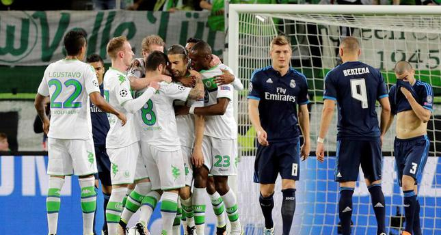 Wolfsburg's players celebrate after Ricardo Rodriguez scored the opening goal from the penalty spot during the Champions League first leg quarter final match against Real Madrid in Wolfsburg last week.