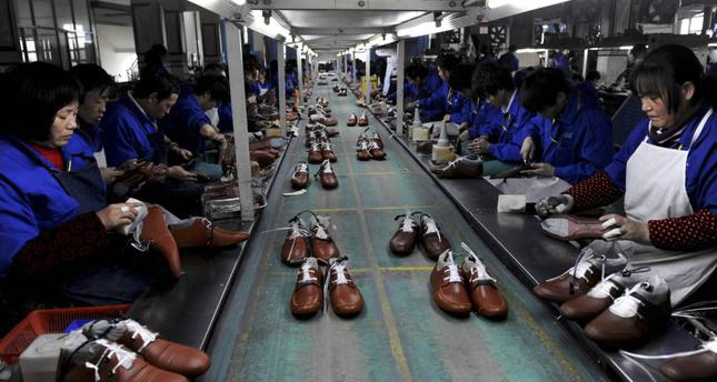 Employees work at a shoe factory in Lishui, Zhejiang province, China.