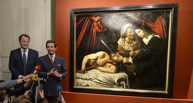 Art expert Eric TurquinR and Auctioneer Marc Labarbe L pose for photographs as they present the piece 'Judith Beheading Holofernes'. EPA Photo