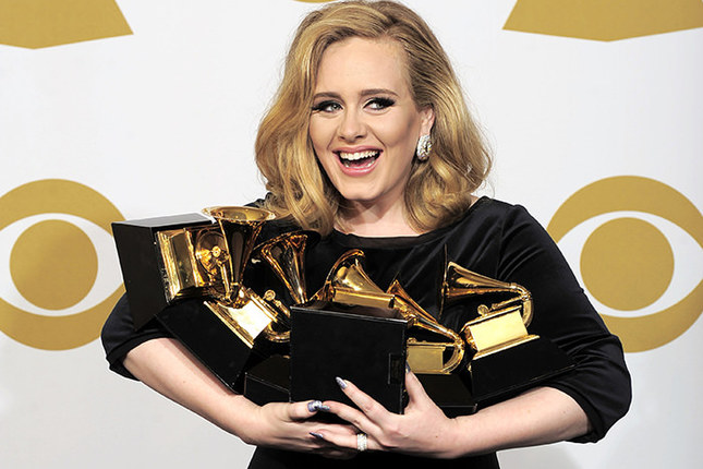 Adele poses backstage with her six awards at the 54th annual Grammy Awards on Sunday, Feb. 12, 2012 in Los Angeles, USA AP Photo
