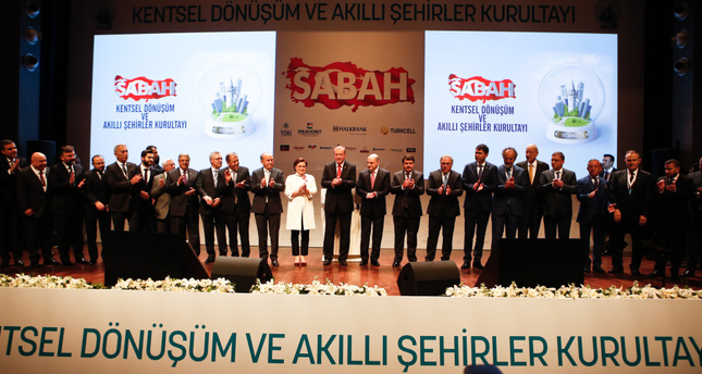 President Recep Tayyip Erdoğan (C) and CEOs of Turkey's leading construction companies standing for a family photo at the Urban Development and Smart Cities Assembly organized by the Sabah daily.