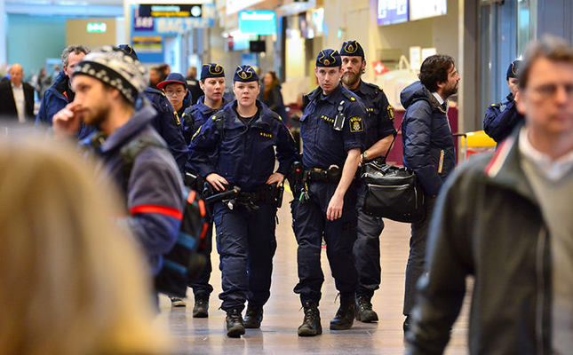 Swedish policemen patrol the Arlanda Airport outside Stockholm, Sweden, March 22, 2016, following the explosions in Brussels on the same day. (Reuters Photo)