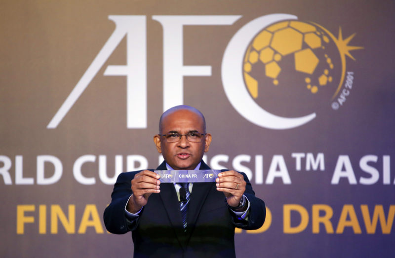 Asian Football Confederation General Secretary Windsor John holds the country name card of China in the draw for 2018 FIFA World Cup Russia Asian qualifiers final round in Kuala Lumpur.