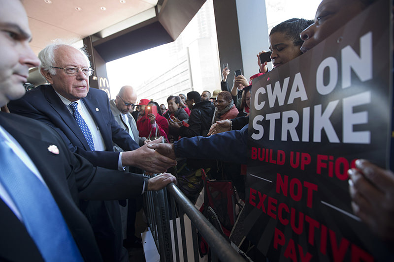 Democratic presidential candidate, Sen. Bernie Sanders, I-Vt., greets a CWA worker at a Verizon workers picket line, Wednesday, April 13, 2016. (AP Photo)