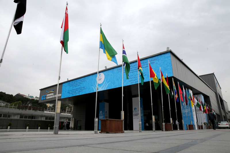 Flags of OIC countries and logo fly outside the Istanbul Congress Center. Police closed down roads leading to the event venue for the summit.