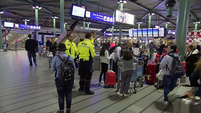 This image made from a video from RTL shows passengers waiting at Schiphol Airport in Amsterdam, Tuesday, April 12, 2016 (AP Photo)