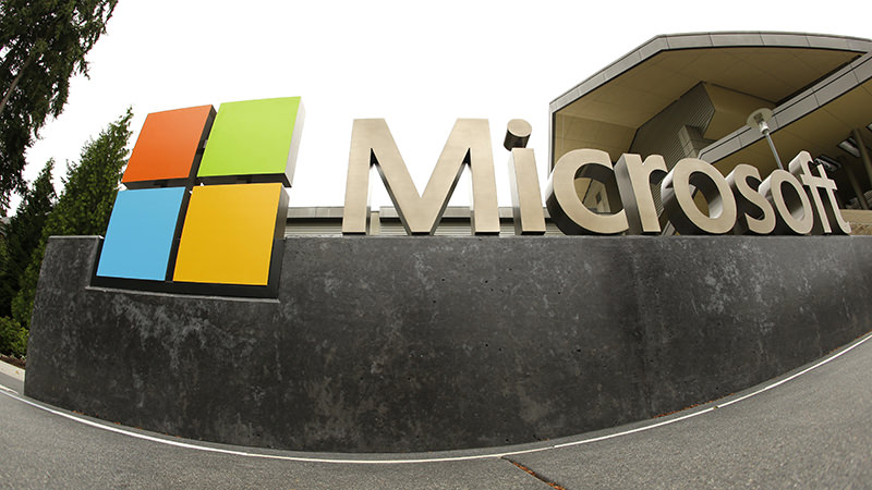 This July 3, 2014, file photo, shows the Microsoft Corp. logo outside the Microsoft Visitor Center in Redmond, Wash. (AP Photo)