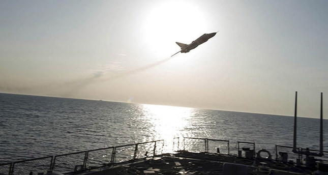 An U.S. Navy picture shows what appears to be a Russian Sukhoi SU-24 attack aircraft flying over the U.S. guided missile destroyer USS Donald Cook in the Baltic Sea in this picture taken April 12, 2016  (Reuters Photo)