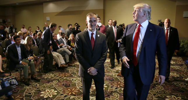 Republican presidential candidate Donald Trump, right, walks with his campaign manager Corey Lewandowski after speaking at a news conference in Dubuque, Iowa. (AP Photo)
