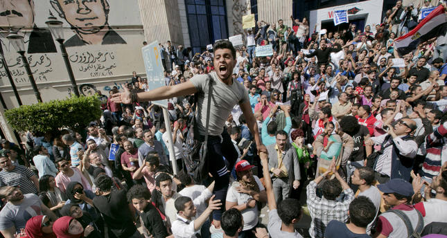 Egyptians shout slogans against el-Sisi during a protest against the decision to hand over control of two strategic Red Sea islands to S. Arabia, in Cairo, Egypt, Friday, April 15, 2016. (AP Photo)