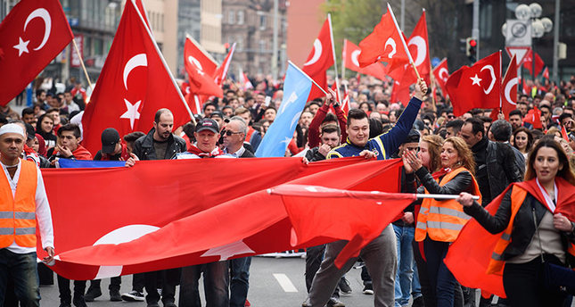 Turks of the Turkish Committee in Germany carry Turkish national flags during a rally entitled 'Peace march for Turkey' in Nuremberg, Germany, April 10, 2016. (EPA Photo)