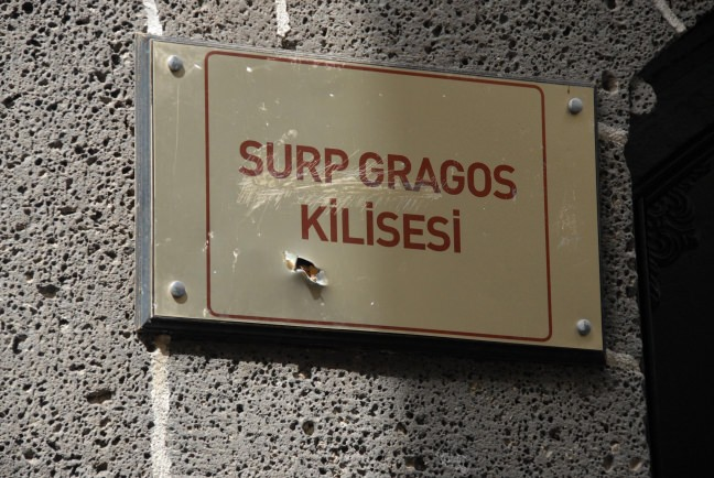 The sign of Surp Giragos Church is seen with bullet marks, which occurred as a result of PKK terror attacks