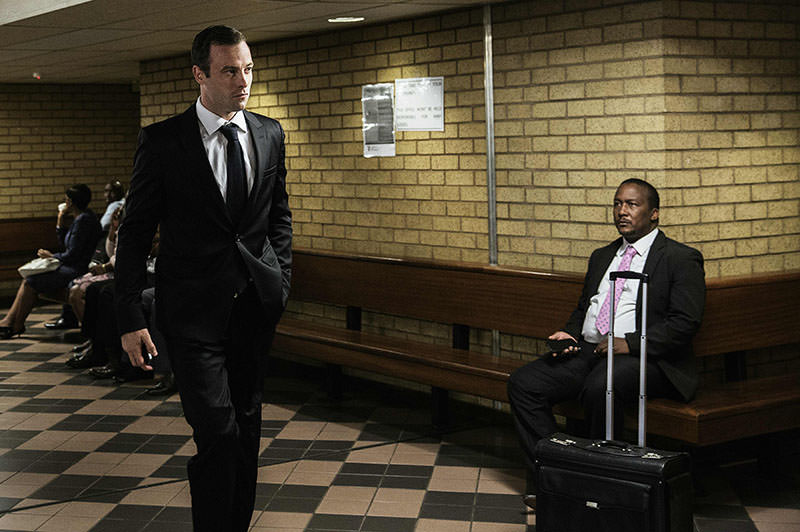 South African Paralympian Oscar Pistorius (L) arrives at Pretoria High Court for today's postponement hearing in his murder case on April 18, 2016 in Pretoria (AFP).