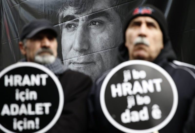Two men carrying placards reading ,For Hrant, For Justice, at a ceremony to remember the late journalists on Jan. 19, 2016.