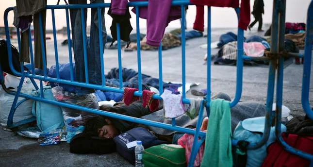 Refugees sleeping at the port of Chios, where they are camping out.