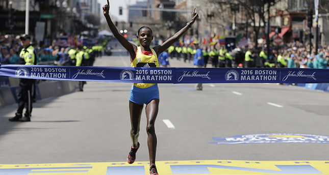 Atsede Baysa, of Ethiopia, crosses the finish line to win the women's division of the 120th Boston Marathon on Monday, April 18, 2016. (AP Photo)