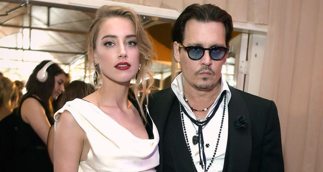 Johnny Depp's wife avoids conviction for smuggling dogs