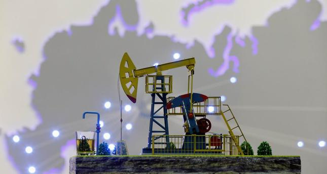 Shares and currencies follow oil down after Doha disappointment