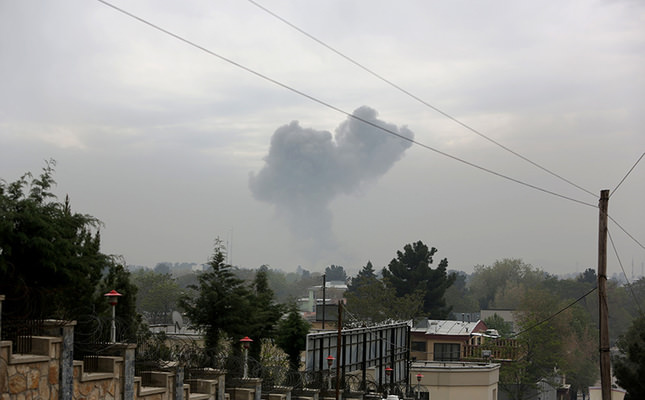 Smoke rises after a suicide attack in Kabul, Afghanistan, April 19, 2016. Sediq Sediqqi, spokesman for the Afghan Interior Ministry, says the suicide attack was followed by gunfire, and the area has been surrounded by security forces. (AP Photo)