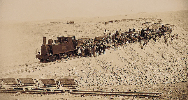This file photo displayed in an exhibition to commemorate 100th year of Hejaz Railway shows engineers and workers during the construction phase of the railway.