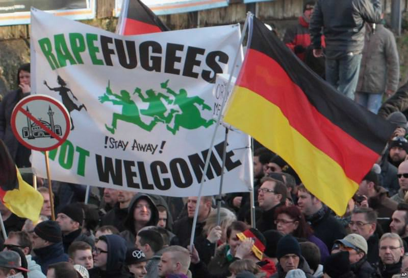 Supporters of far-right groups at in a protest against refugees and Islam.