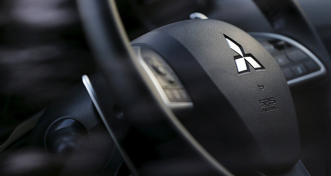 The logo of Mitsubishi Motors is seen on a steering wheel of the company's car at the company's showroom in Tokyo November 6, 2013. (Reuters Photo)