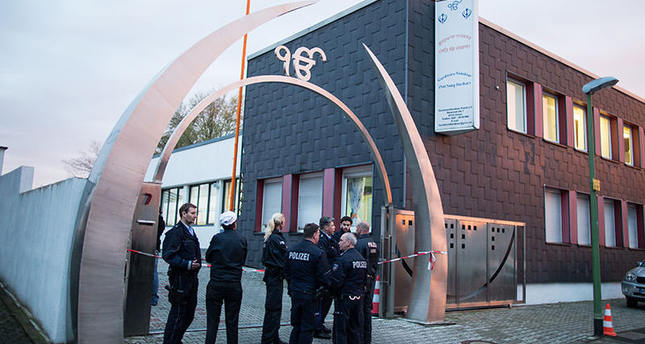 Police officers stand in front of Sikh temple after 3 people have been injured in deliberate explosion on April 16, 2016 in western German city of Essen. AP