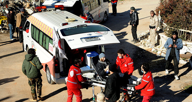 In this file photo released on December 28, 2015, Syrian Red Crescent workers carry a wounded Syrian opposition fighter, during an evacuation from the town of Zabadani, in Syria (AP Photo)