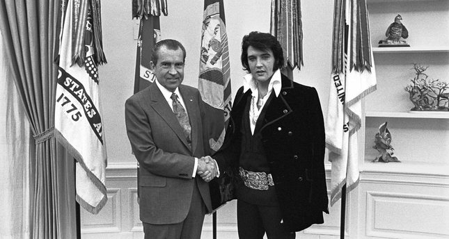 President Nixon shakes hands with Elvis Presley in the Oval Office in Washington in December 1970 after the little-known meeting.